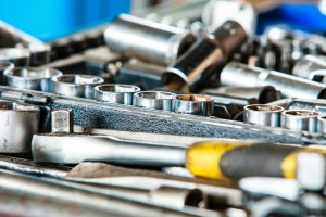 Assortment Kit Of Adjustable Metallic Tools In Mechanic Garage
