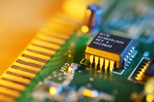 Electronic chip on circuit board. Macro close-up, shallow DOF.