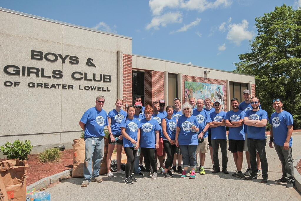 Setra associates pose in front of the Boys & Girls Club of Greater Lowell.