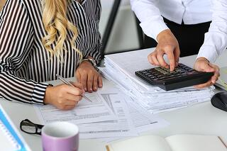 bigstock-Two-Female-Accountants-Countin-105729755.jpg