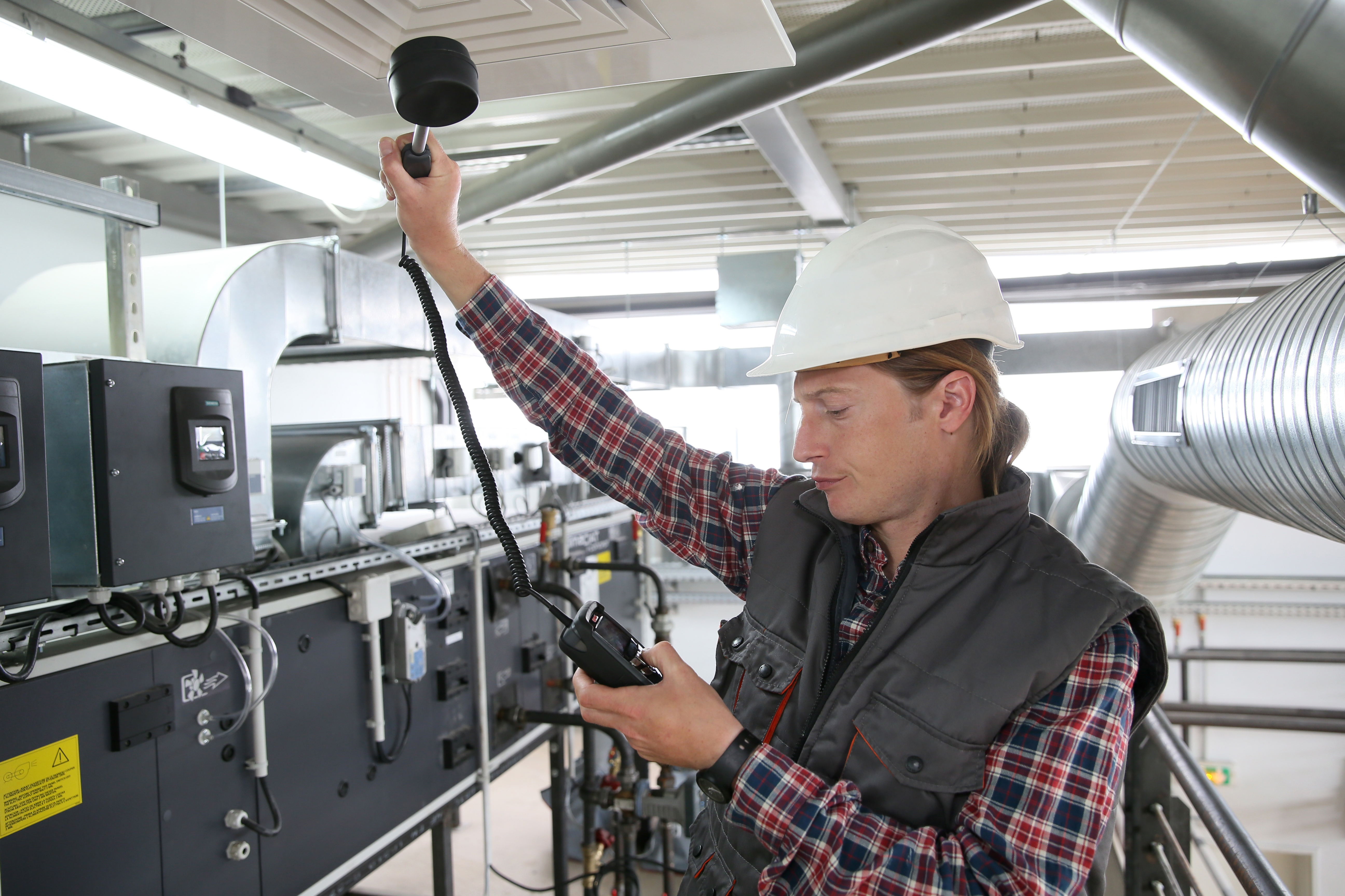 bigstock-Technician-controlling-air-qua-94062203.jpg