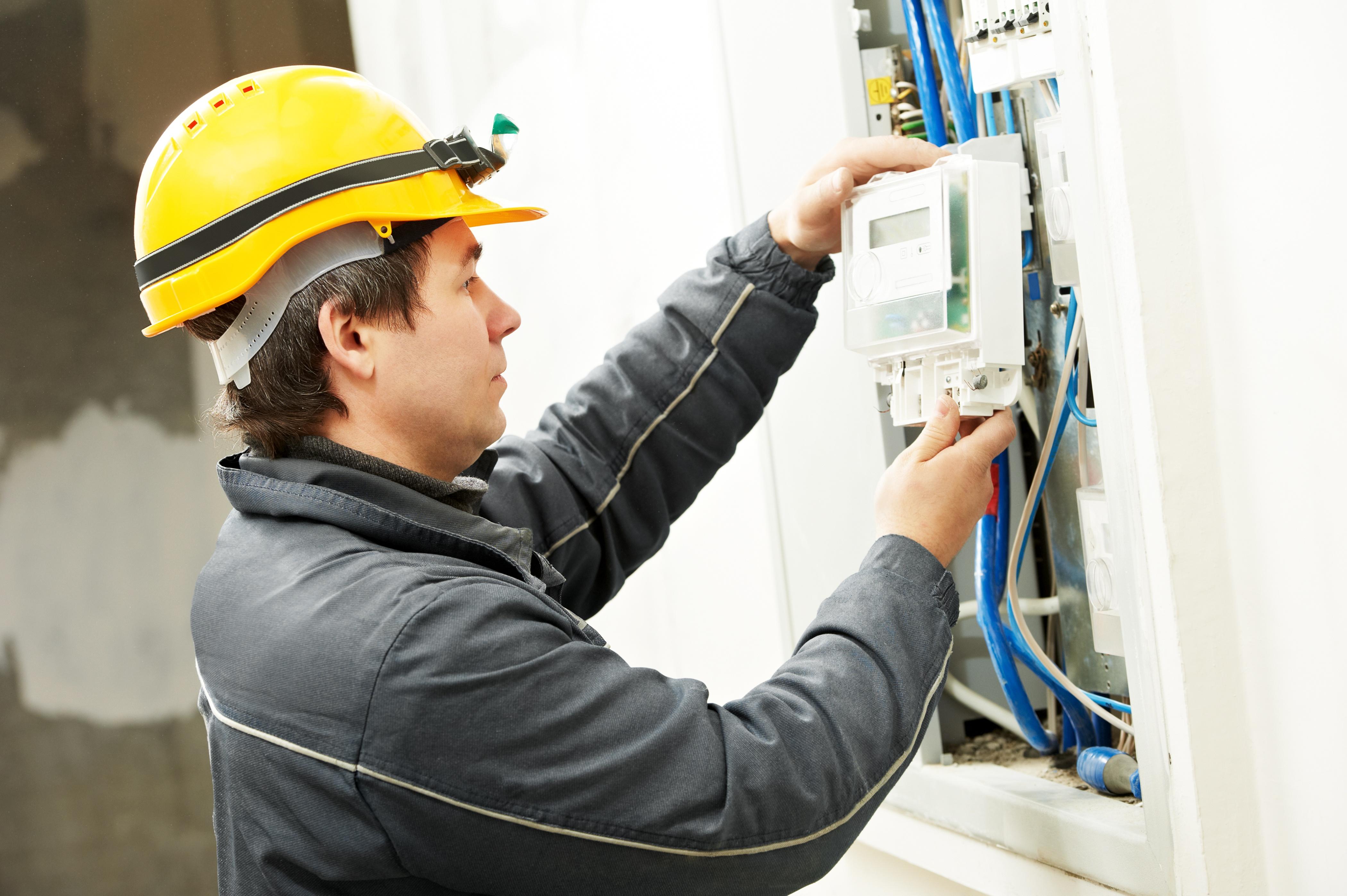 bigstock-Electrician-installing-energy--113637569.jpg