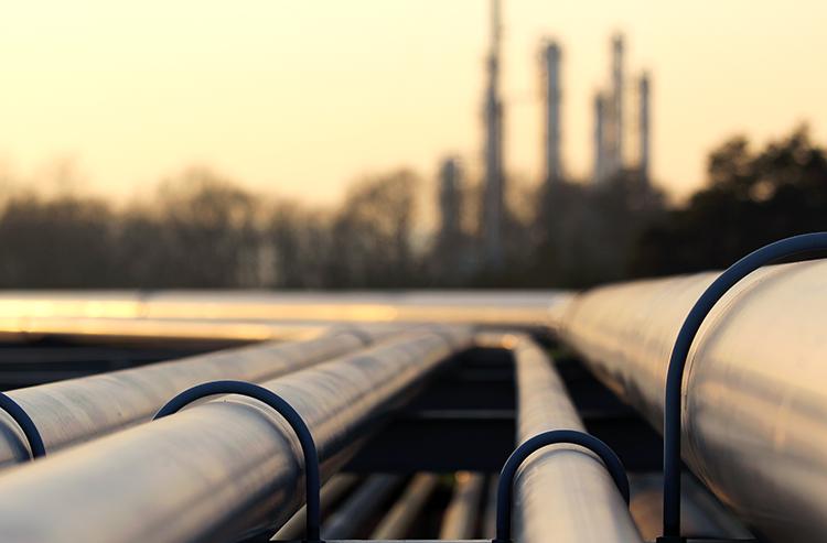 bigstock-Steel-Pipes-In-Crude-Oil-Facto-64167577.jpg