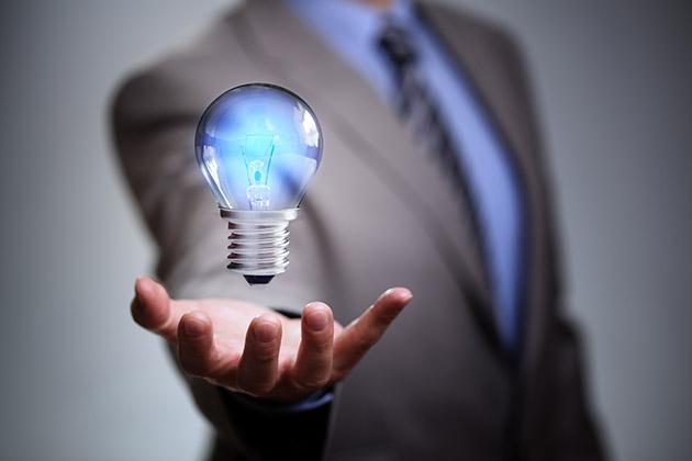 business man levitating lightbulb